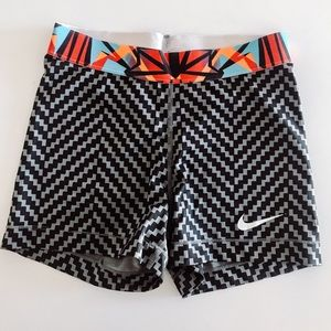 Black and gray Nike pros